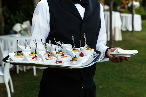 WAITER WORKING AT THE EVENT